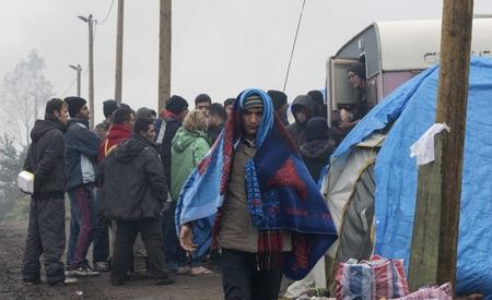 Người tỵ nạn tại khu trại ở Calais (Pháp) - Ảnh: Philippe Wojazer (AFP)
