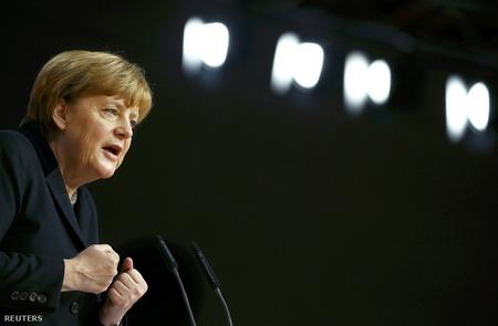 Bài phát biểu kéo dài hơn một tiếng của Angela Merkel đã nhiều lần phải dừng lại vì những tràng pháo tay vang dội - Ảnh: Kai Pfaffenbach (Reuters)