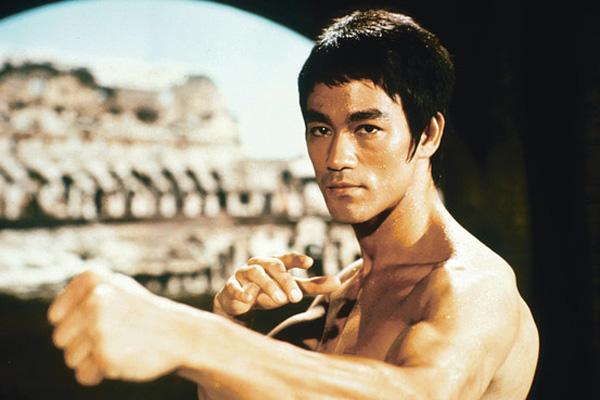 """Thân pháp, bộ pháp và đòn tay của Lý Tiểu Long trong """"Mãnh long quá giang"""" (The way of the dragon, 1972) đã chịu nhiều ảnh hưởng của quyền Anh, mà Muhammad Ali là một trong những nguồn cảm hứng lớn nhất - Ảnh: AFP"""