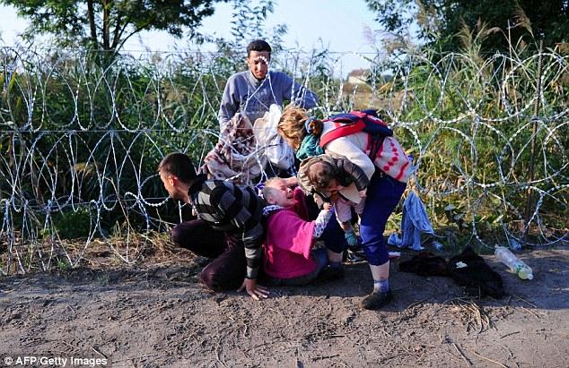 Hungary bị EU lên án vì chính sách hà khắc đối với người tỵ nạn - Ảnh: AFP
